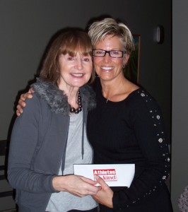 Cecilia Maerov, BCCCPA Director, receiving cheque from Lorie Muller of Athletes In Kind. AIK Raised $11,500 during 2008 for BCCCPA.
